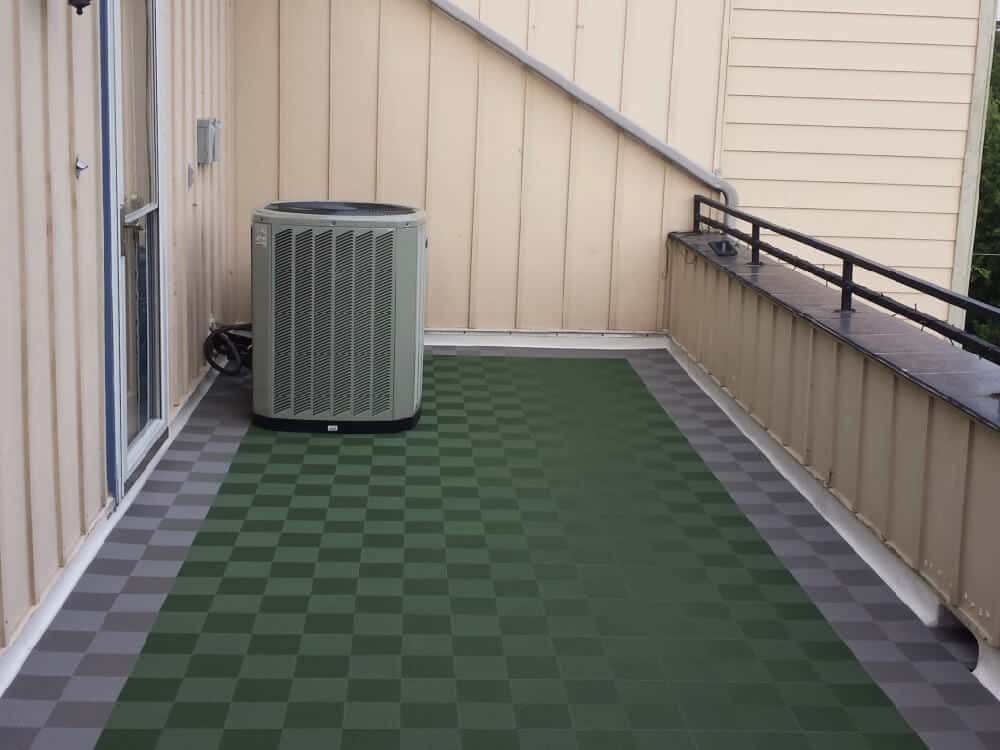 interlocking perforated gray and green tiles balcony patio