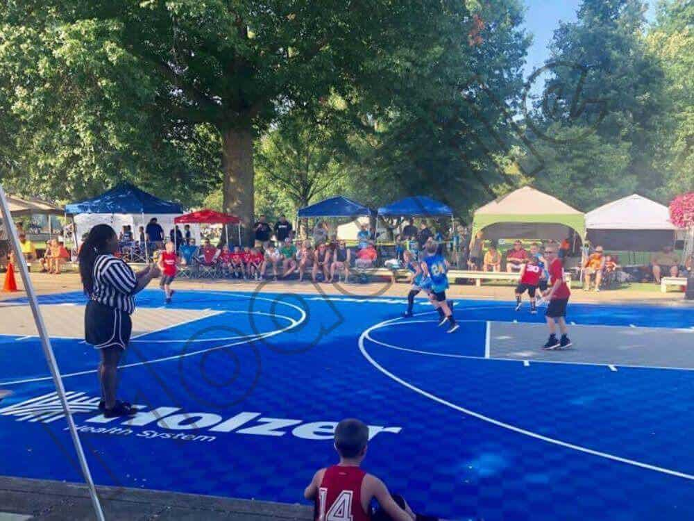 Backyard Basketball Court with Logo - In use